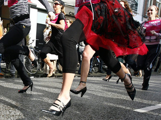 Competitors in the Stiletto Run race over 350 metres in PC Hooftstraat in Amsterdam