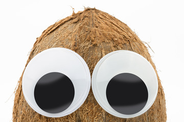 coconut with googly eyes on white background