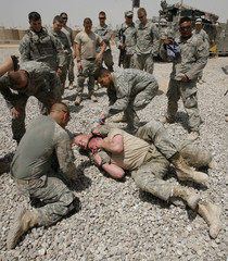 U.S. soldiers wrestle for fun at a military camp in Baquba