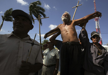 A sugar plantation ex-worker suffering from kidney failure is crucified during a protest in front of Pellas Group building in Managua