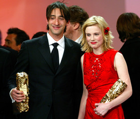 U.S actor Adrien Brody (L) and French actress Isabelle Carre (R) share a laugh at the end of the Fre..