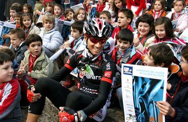 Illes Balears rider Valverde talks with children before start of Mallorca's Challenge's third stage in Pollensa