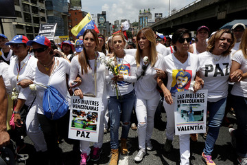 Lilian Tintori, wife of jailed Venezuelan opposition leader Leopoldo Lopez, attends a women's march to protest against President Nicolas Maduro's government in Caracas,