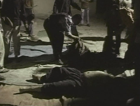 A video grab shows various bodies lying on the floor at a mosque in the Shaab district of eastern Baghdad