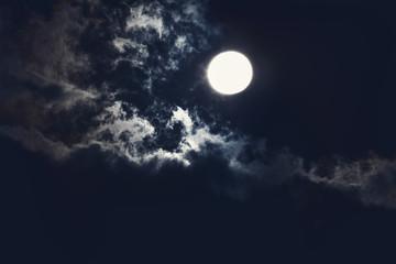 bright moon on the dark sky