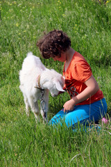 girl with kid in a meadow. photo