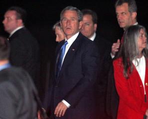 U.S. President George W. Bush walks as he arrives at a military base in Rawalpindi