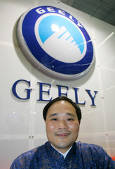 Li Shufu CEO of Chinas first private car maker Geely sits under Geely logo in Frankfurt.