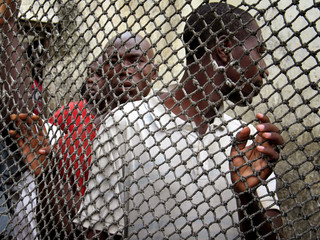 Prisoners line up inside Douala central prison in Cameroon