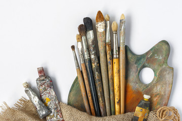 Brushes, palette and tubes with paint
