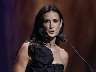 Actress Demi Moore presents one of the Clinton Global Citizen Awards at the Clinton Global Initiative in New York