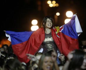 A fan draped in Serbia's national flag greets singer Serifovic in Belgrade