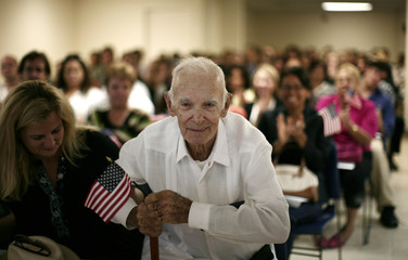 Former Cuban exile Jose Temprana, 105, attends a ceremony of naturalization to become a U.S. citizen in Miami