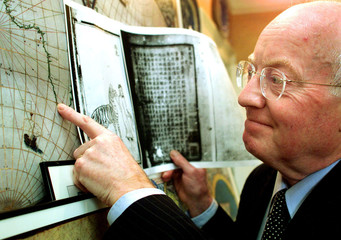 BRITISH HISTORIAN GAVIN MENZIES LOOKS AT AN OLD MAP OF THE WORLD AT HISHOME IN LONDON.