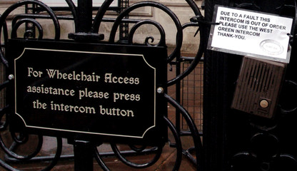 Sign notifying users that wheelchair access assistance button is out of order is seen outside High Court ...