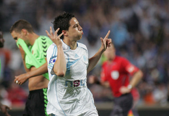 Olympique Marseille's Samir Nasri celebrates after his goal against Sedan in Marseille