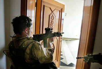 UNIDENTIFIED ROYAL MARINES CLEAR SADDAM HUSSEIN'S PALACE IN BASRA.