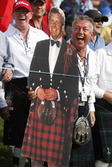 A fan holds a cut out of Montgomerie whilst watching the action during foursome play in the 37th Ryder Cup Championship at the Valhalla Golf Club in Louisville