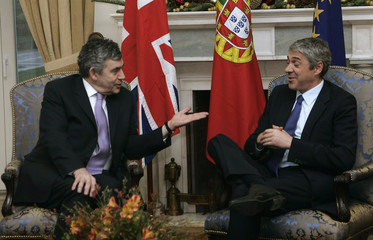 Britain's Prime minister Gordon Brown talks with his Portuguese counterpart Jose Socrates in St Bento palace in Lisbon