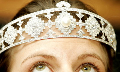 A model wears a Cartier diamond and pearl bandeau, estimated to sell for $150,000 - $200,000, owned ..