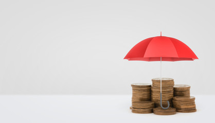 A red open umbrella vertically placed over several stacks of golden coins on white background.