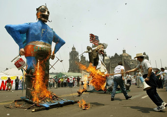 WORKERS BURN AN EFFIGY OF MEXICAN PRESIDENT FOX DURING MAY DAY PROTESTIN MEXICO CITY.