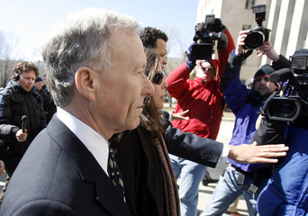 """Lewis """"Scooter Libby passes members of media outside the U.S. Federal Courthouse in Washington"""