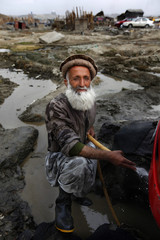 A worker poses at a carwash along Qabri Gora Road in Kabul