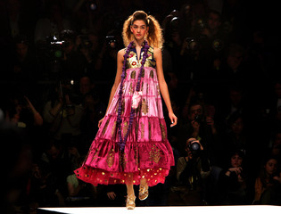 A model wears a creation by Arora at his show during London Fashion Week