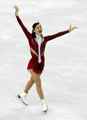 Shizuka Arakawa finishes her women's short program during the Figure Skating competition at the Winter Olympic Games