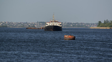 The cargo ship  of the river