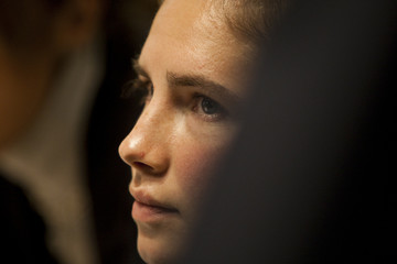 American university student Amanda Knox looks on during a murder trial session in Perugia