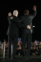 U.S. Democratic presidential nominee Obama and former President Clinton wave to supporters during campaign rally in Kissimme