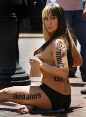 Topless and wearing paint markings that mimic a butcher's diagram of body parts, model, actor, and p..