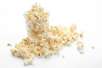 Popcorn in the glass on white background - Soft focus
