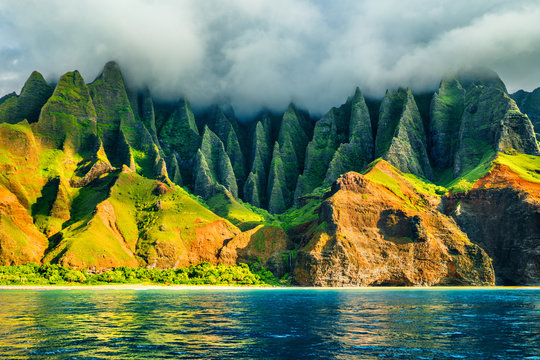 Na Pali coast, Kauai, Hawaii view from sea sunset cruise tour. Nature coastline landscape in Kauai island, Hawaii, USA. Hawaii travel.