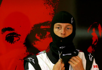 Honda Formula One driver Button of Britain puts on baclava during free practice session in Italy