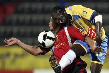 Al-Rayyan's Da Silva fights for the ball with Al-Gharafa's Koussi during the Qatar Stars League soccer match in Doha