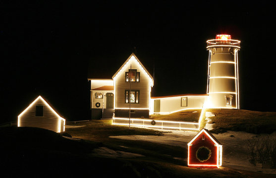 The Cape Neddick 'Nubble' Lighthouse is illuminated for Christmas in York