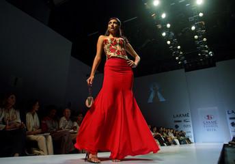 Model showcases creation by designer Symons at India's fashion week in Mumbai