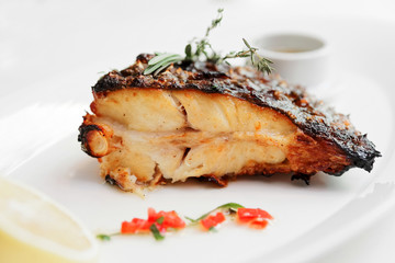 Grilled flounder with lemon and savory sauce, toned
