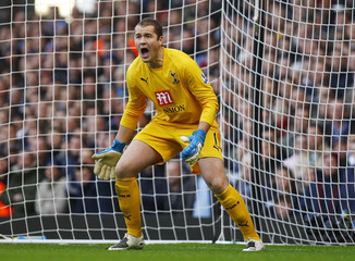 Tottenham Hotspur goalkeeper Robinson reacts during English Premier League match against West Ham United in London