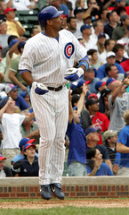 Cubs Lee watches his home run in the fourth against the Cardinals in Chicago.