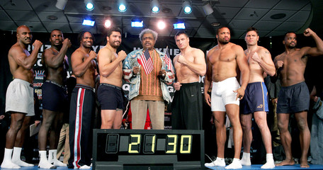 Boxing heavyweights and promoter King stand on a truck scale at New York's Madison Square Garden.