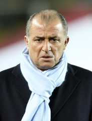 Turkey's head coach Terim walks into Ali Sami Yen Stadium prior to their Euro 2008 Group C qualifying soccer match against Bosnia in Istanbul