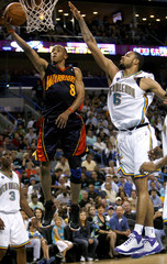 Golden State Warriors guard Ellis shoots over New Orleans Hornets center Chandler during the second half of their NBA basketball game in New Orleans
