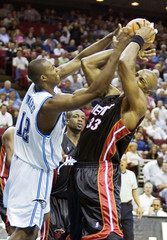 Miami Heat Mourning rips a rebound away from Orlando Magic Howard during second half NBA action in Orlando