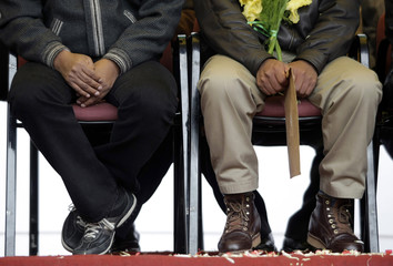 Bolivia's President Evo Morales and miner leader Pedro Montes attend a a ceremony in front of the presidential palace in La Paz