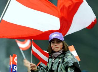AUSTRIAN SKI FAN WAVES FLAG IN ST. ANTON.