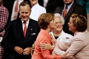 First lady Laura Bush greets President George W. Bush's sister Doro Bush Koch (R) as former first lady ...